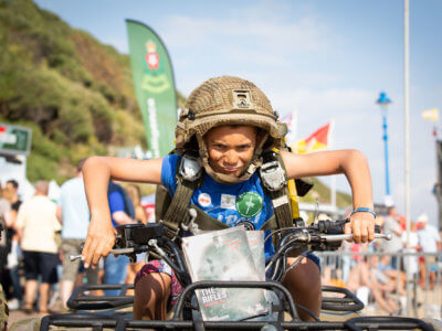 Kid posing on an Army quad bike