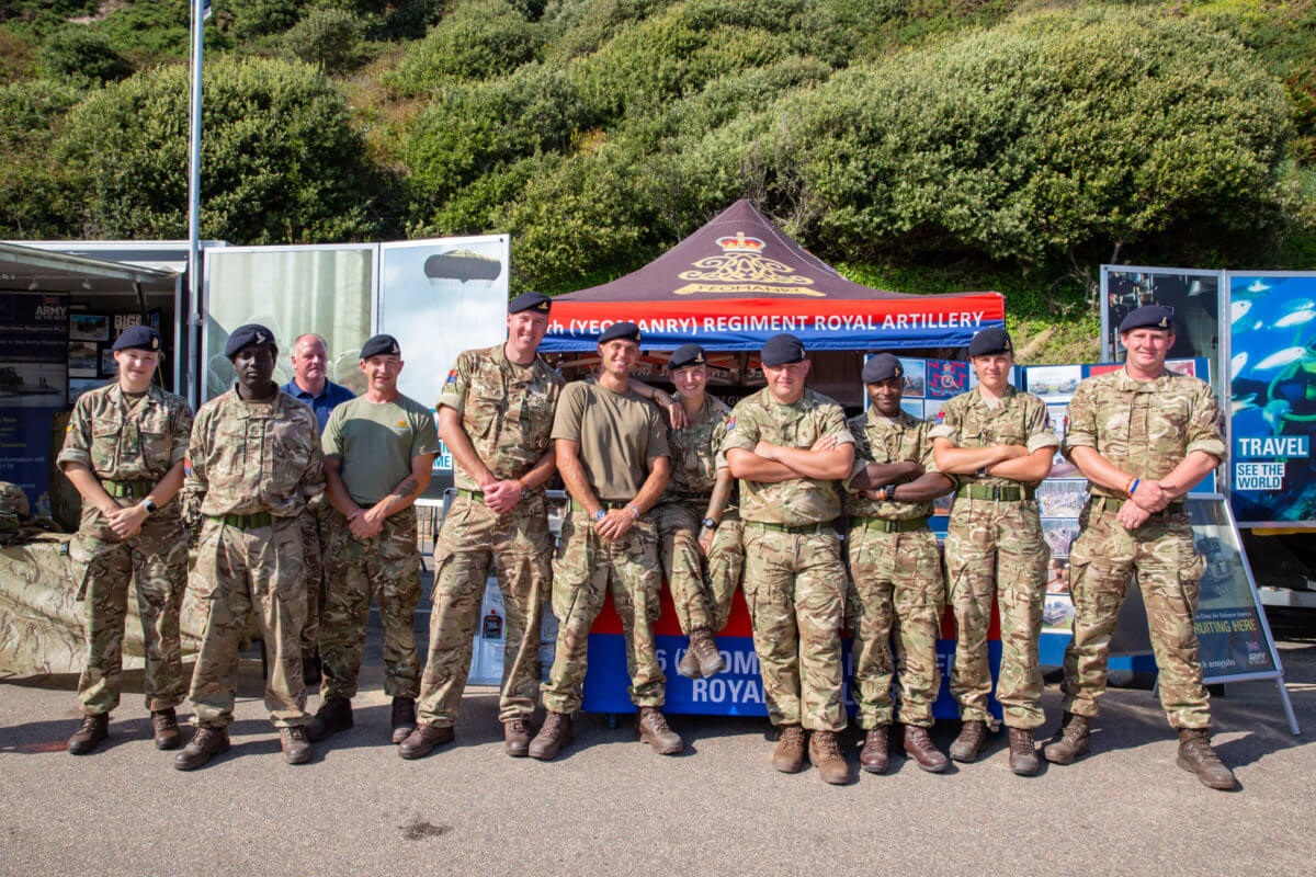 British Army soldiers posing for a photo outside their Air show stand