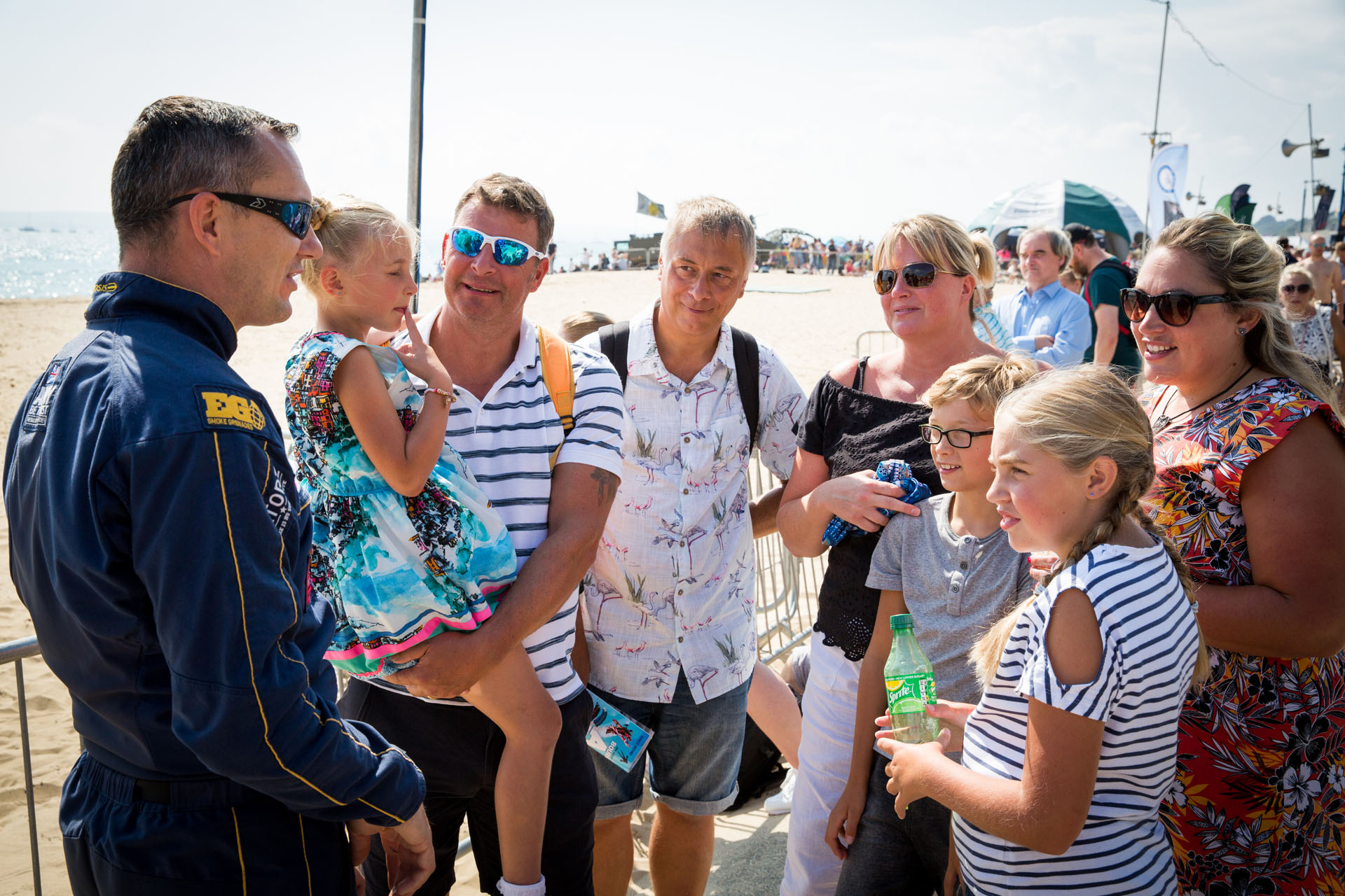 Families chatting with Pilot at the Air Festival
