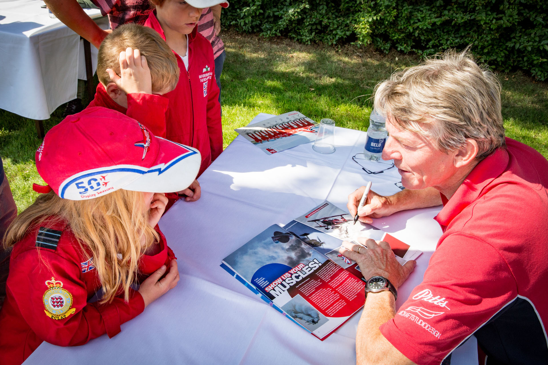 Children getting their brochure signed by a Pilot at the Air Show