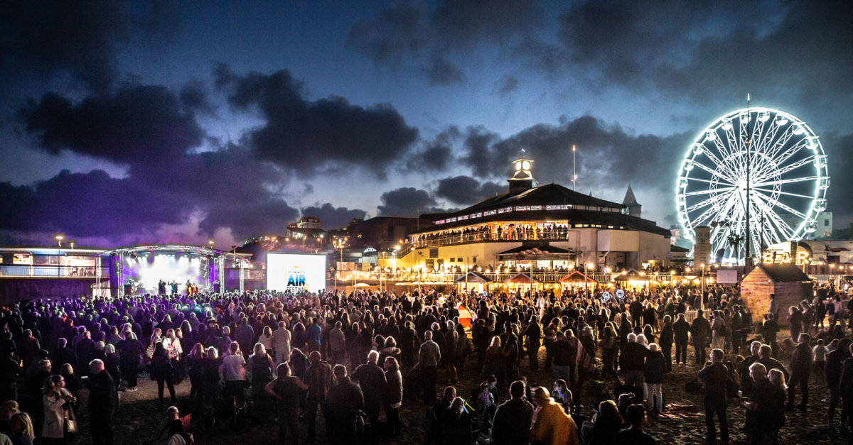 Crowds watching live music next to Bournemouth Pier