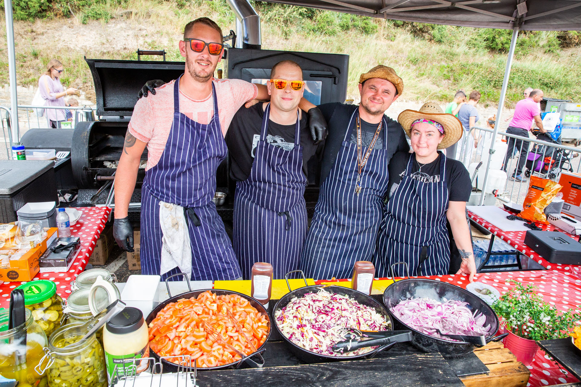4 chefs posing for a photo in the food stall at the air show
