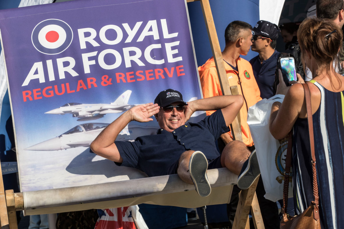 Man posing for a photo on the huge RAF deck chair
