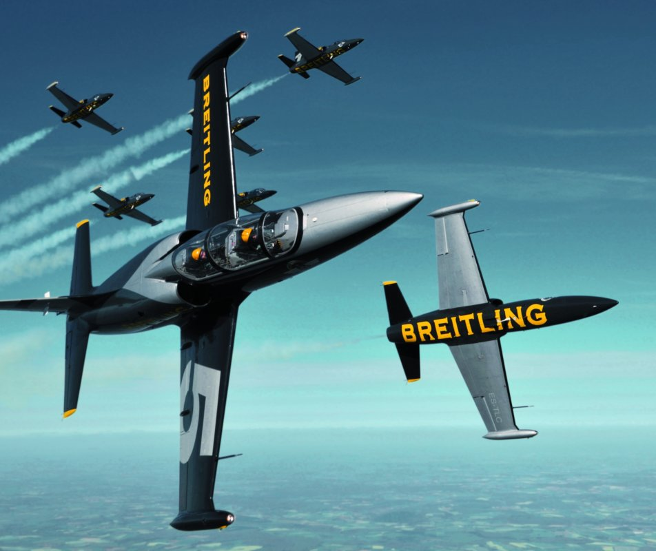 Action shot of Breitling Jet display team flying through the sky