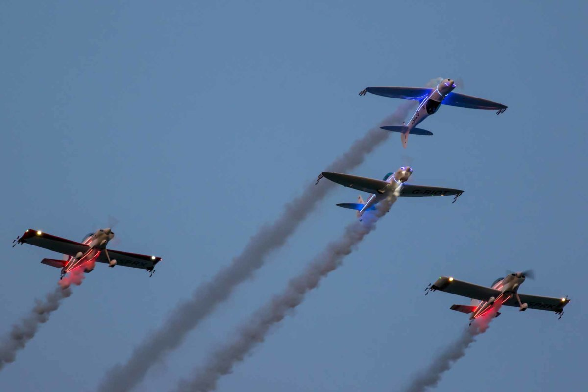 4 planes performing for the crowds in the night sky