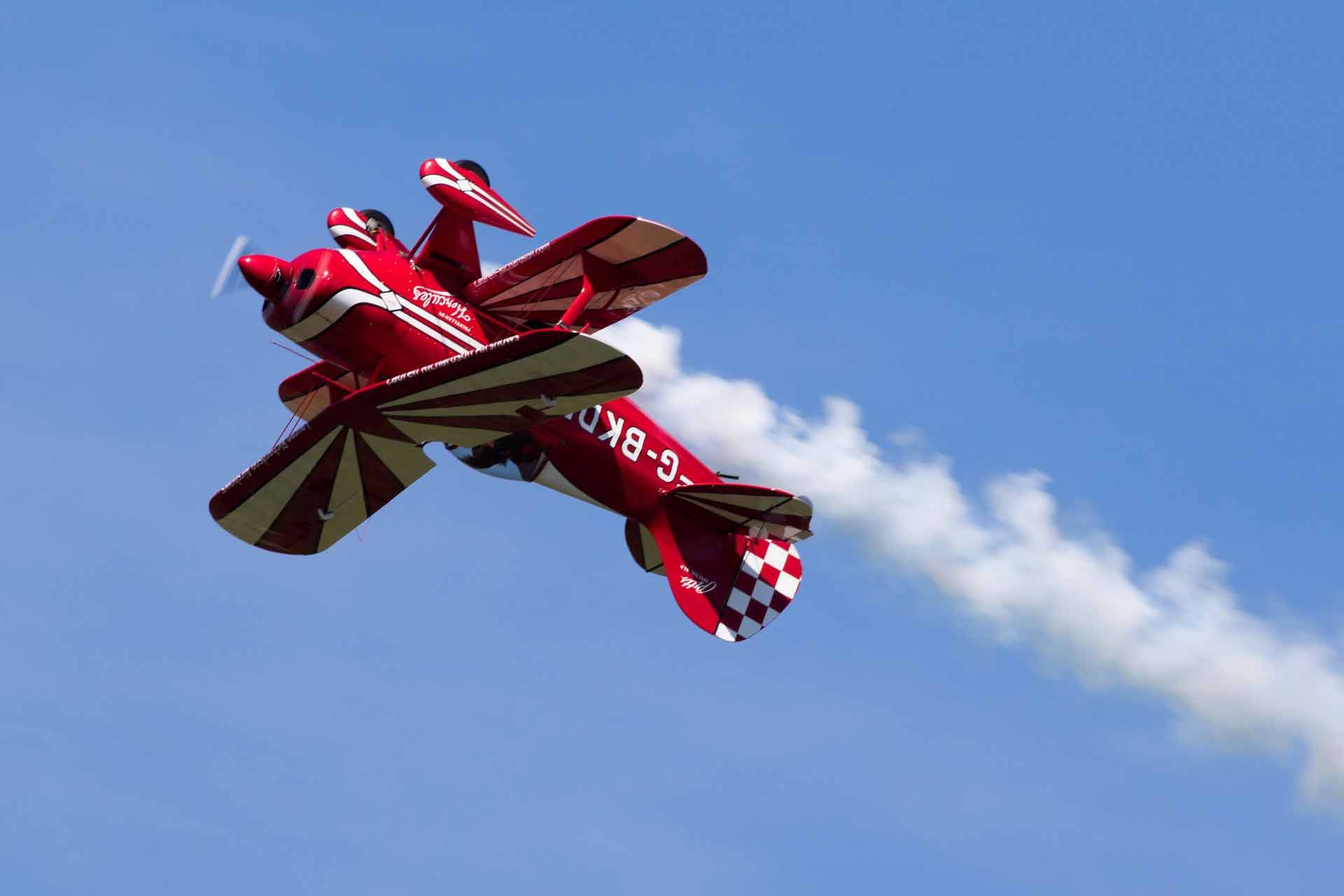 Red muscle plane flying upside at the Bournemouth air show