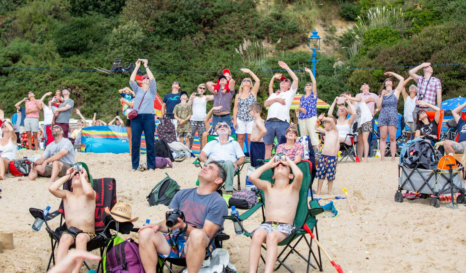 Group of people looking to the skies from Bournemouth beach