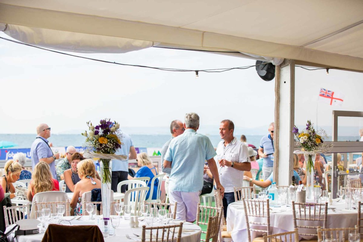 Guests enjoying the hospitality tent whilst chatting and watching the air show