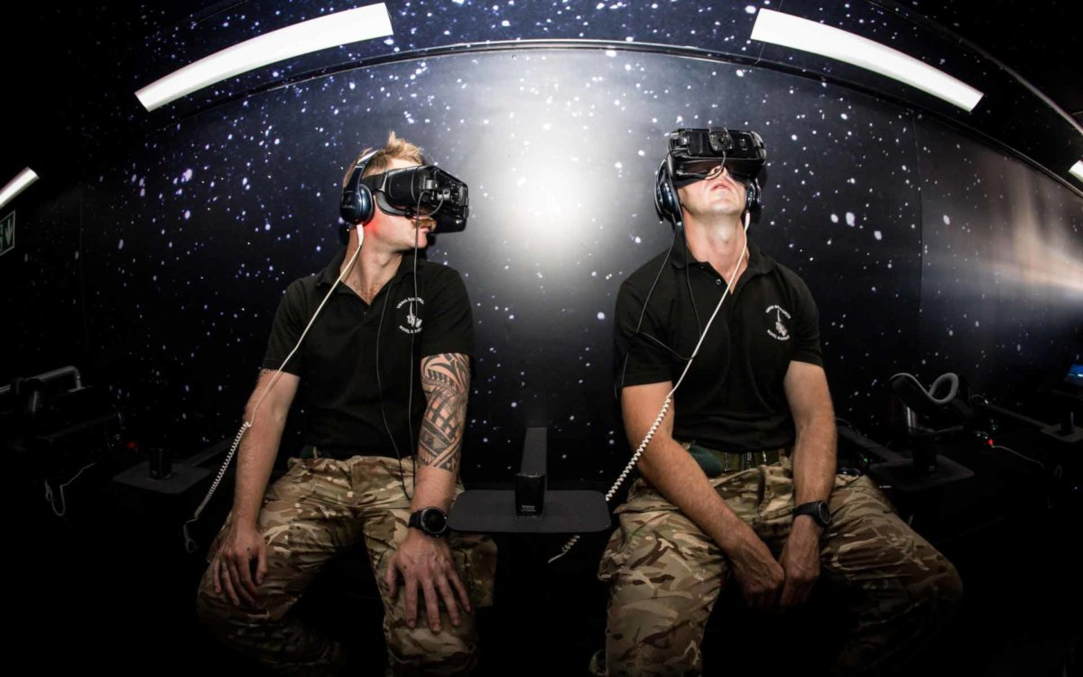 Two soldiers enjoying the VR exhibition at the Air Festival