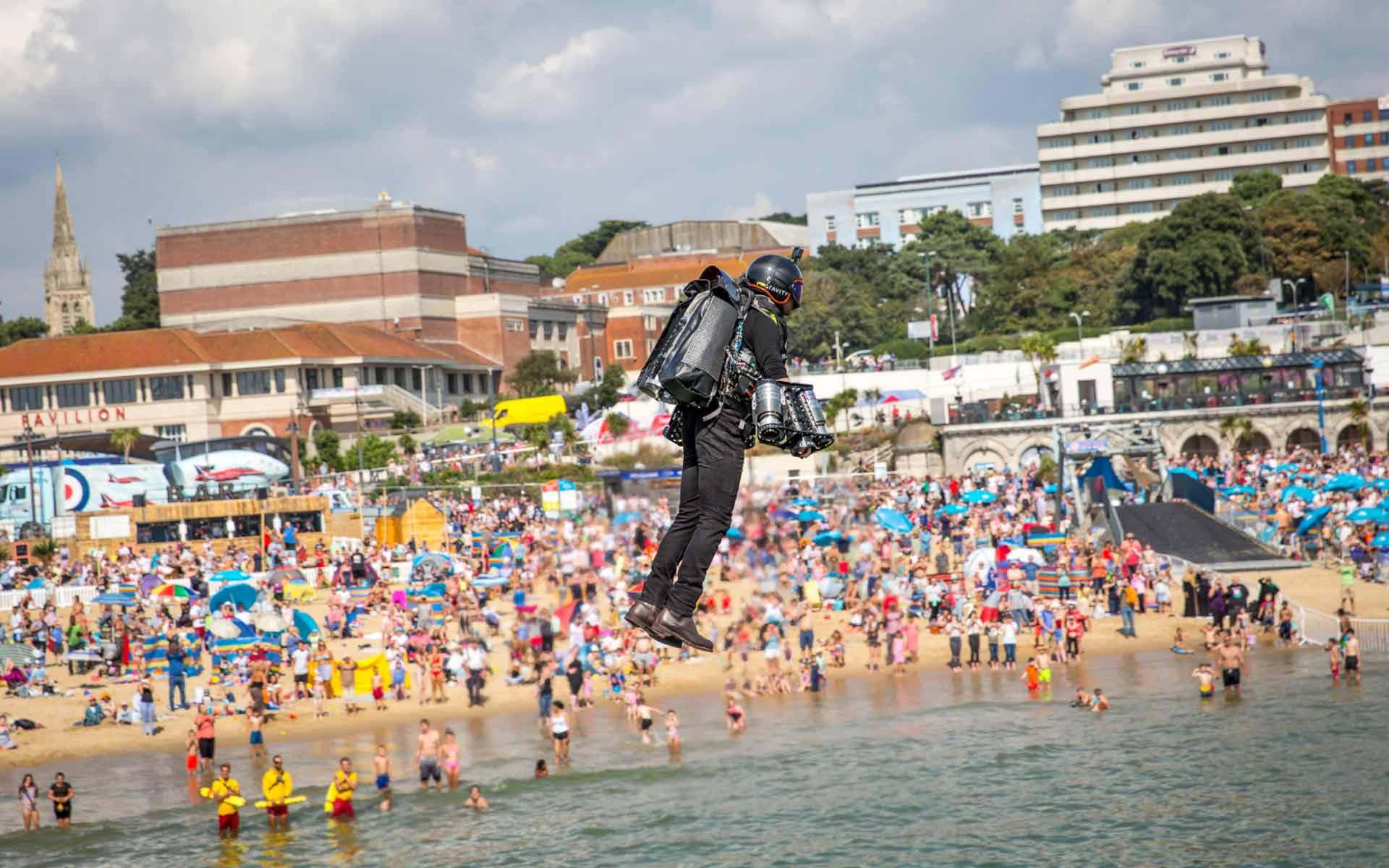 Man flying in front of crowds at Bournemouth beach