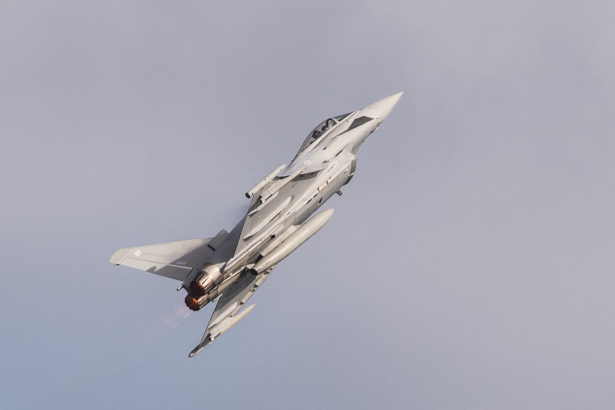 Typhoon twisting through the grey clouds at the air show