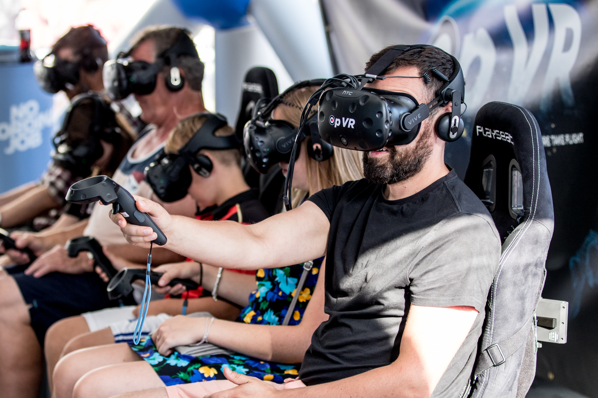 Air Festival visitors enjoying their time in the Virtual reality headset at the RAF village