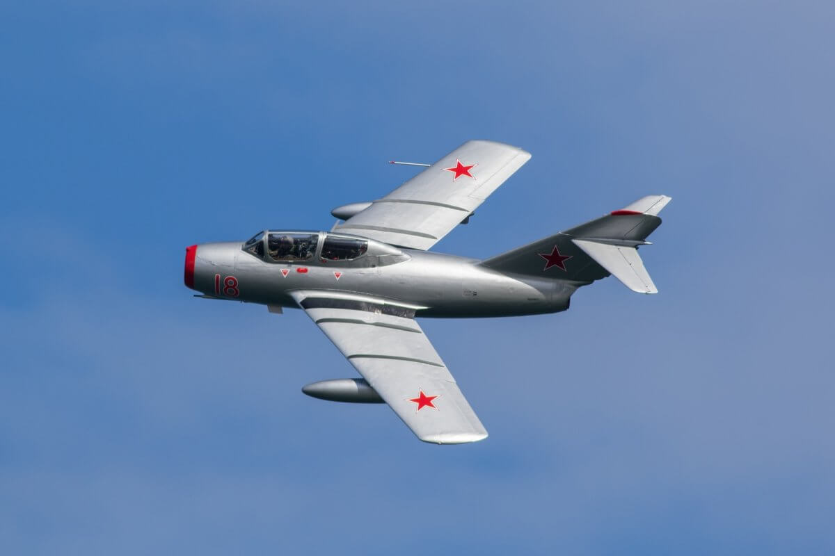 MiG15 aircraft flying through the sky during a beautiful sunny day at the air show