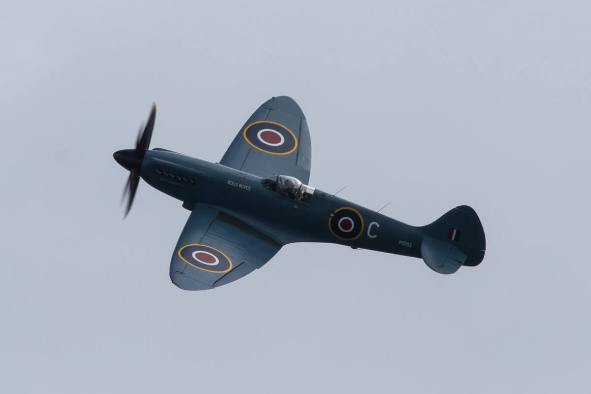 Amazing shot of the Supermarine spitfire performing at an air show on a cloudy day