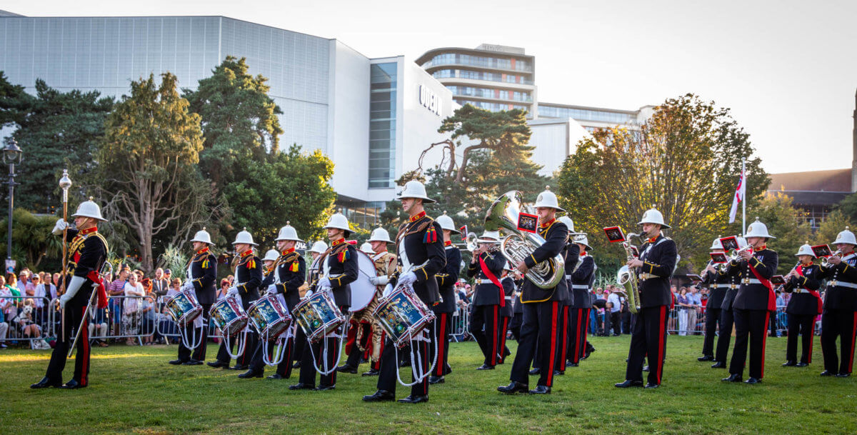 Army band performing in Bournemouth gardens to visitors and onlookers