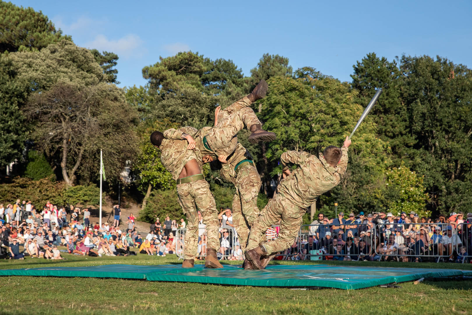Three marine soldiers putting on a fighting display for the crowds in the gardens