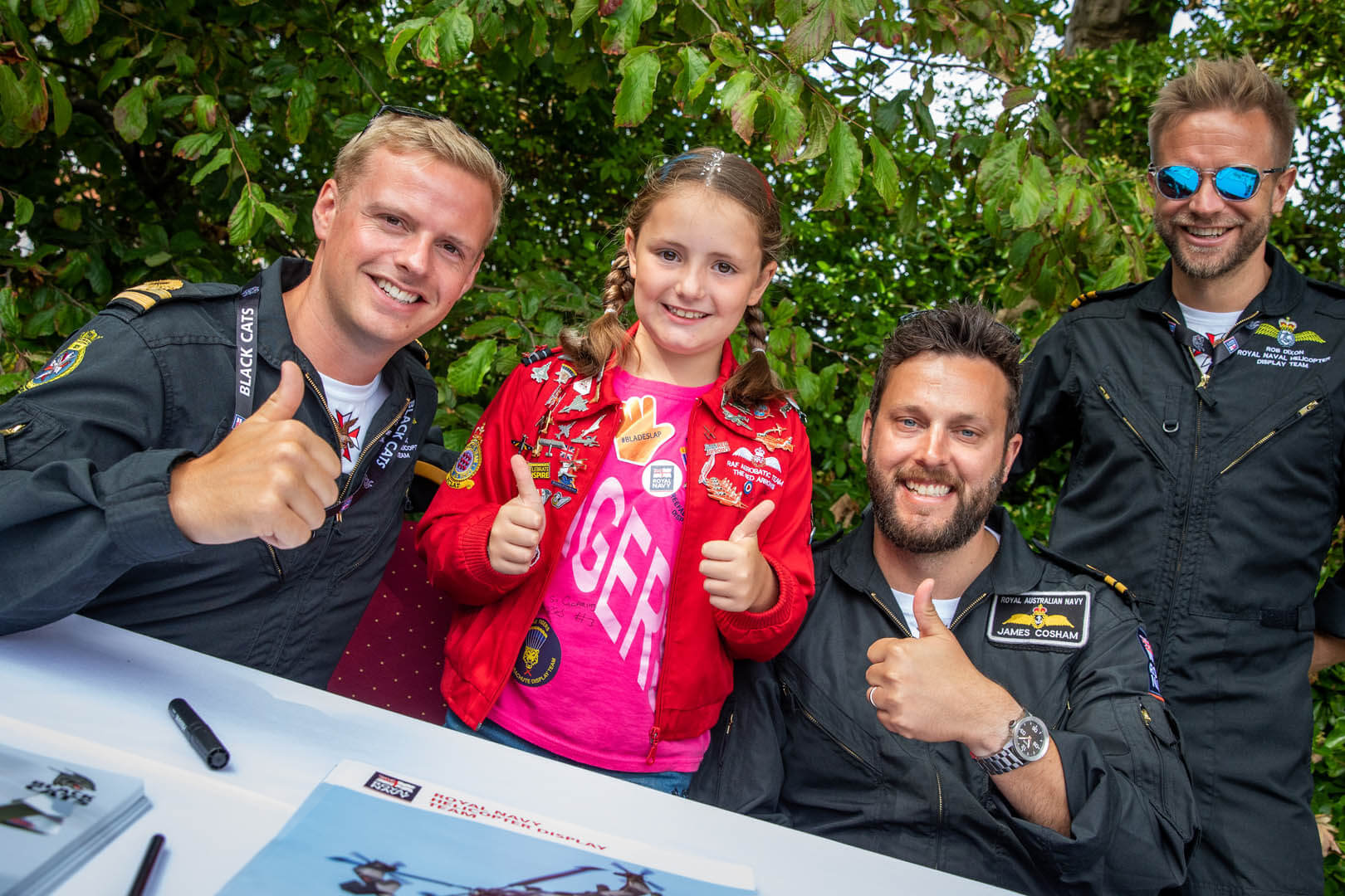 Thumbs up from Royal Air Force pilots and a young fan at the meet and greet event