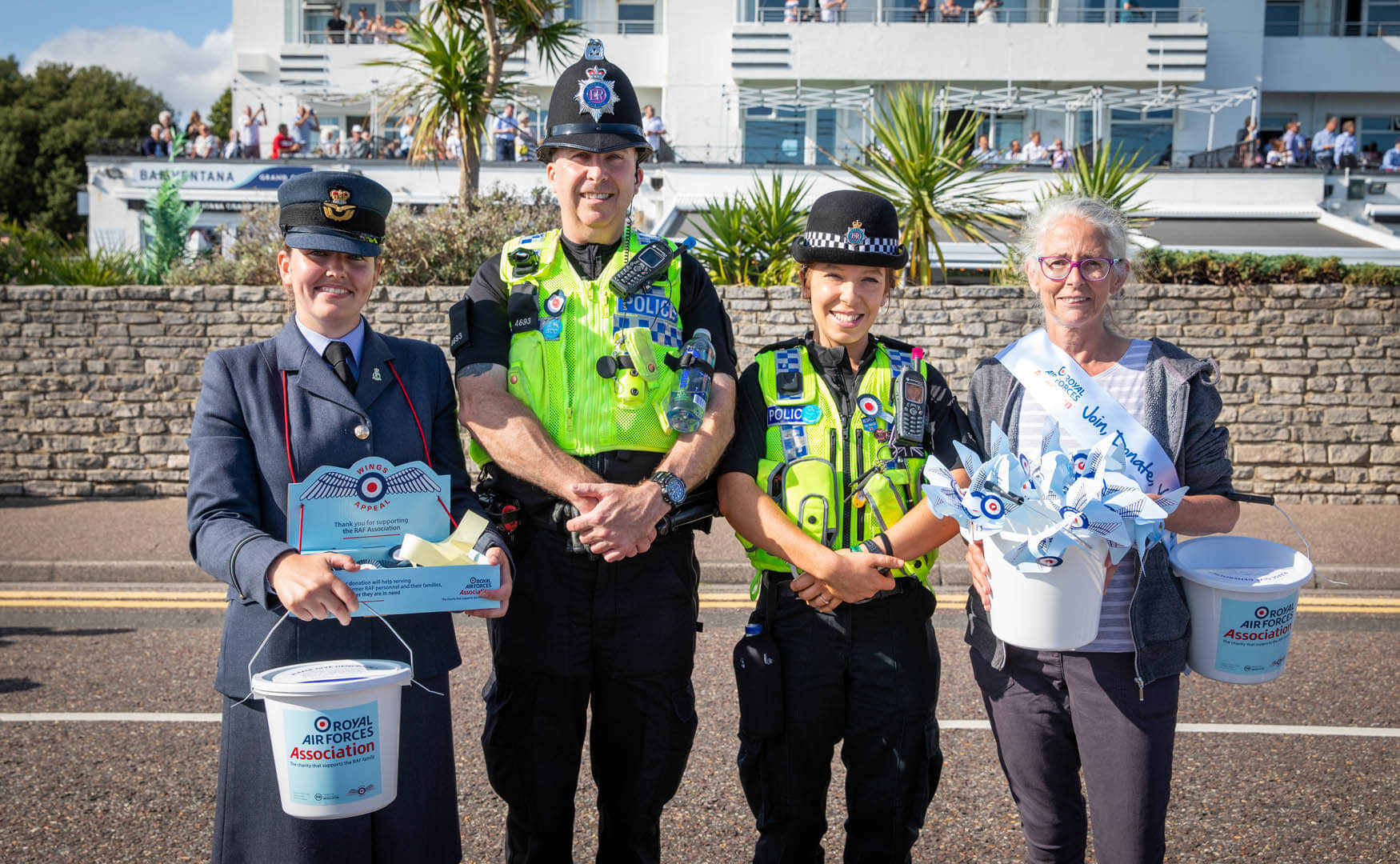 Two police officers having a photo with two royal air force charity members