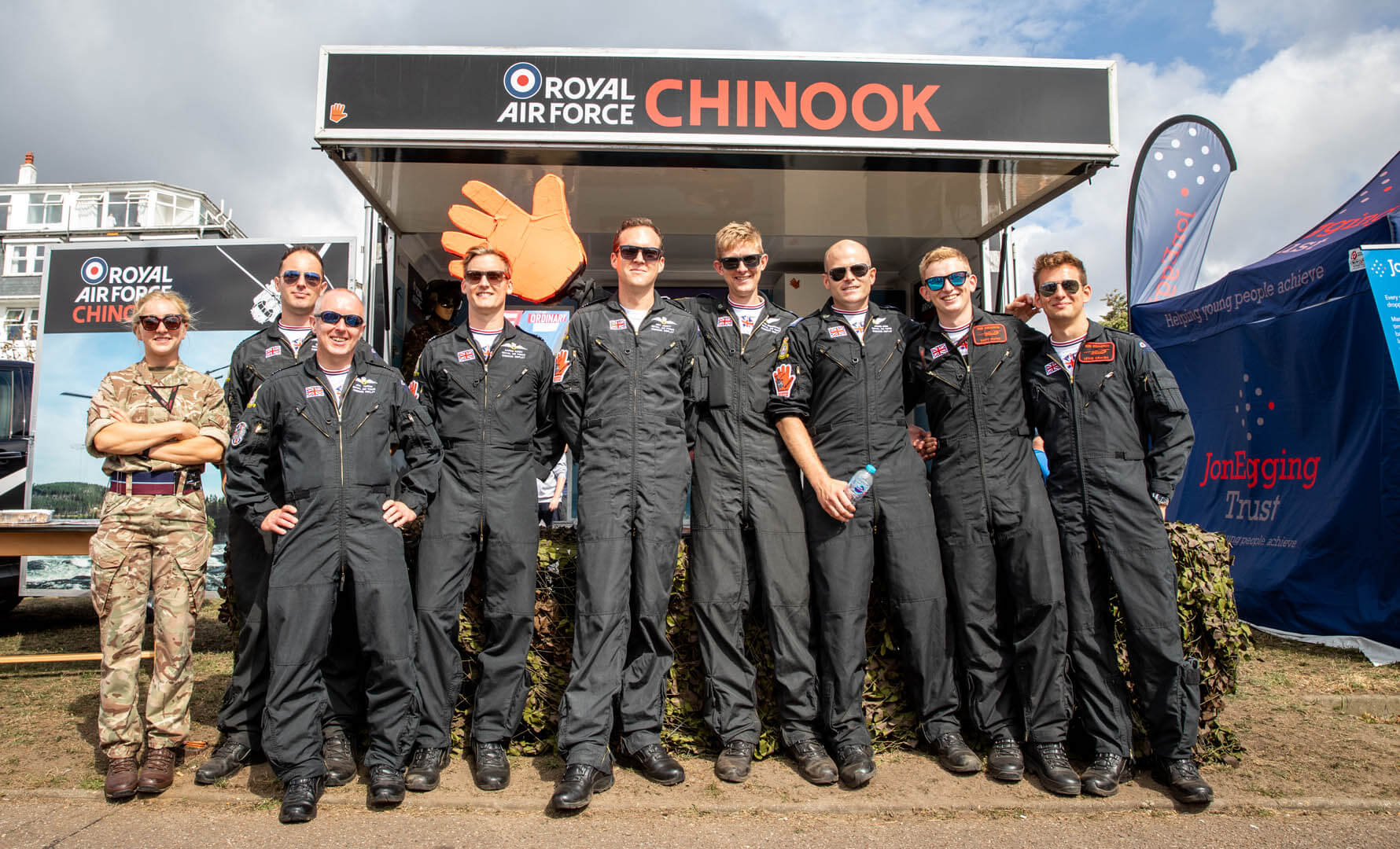 The RAF chinook team posing in front of their stand at the air show