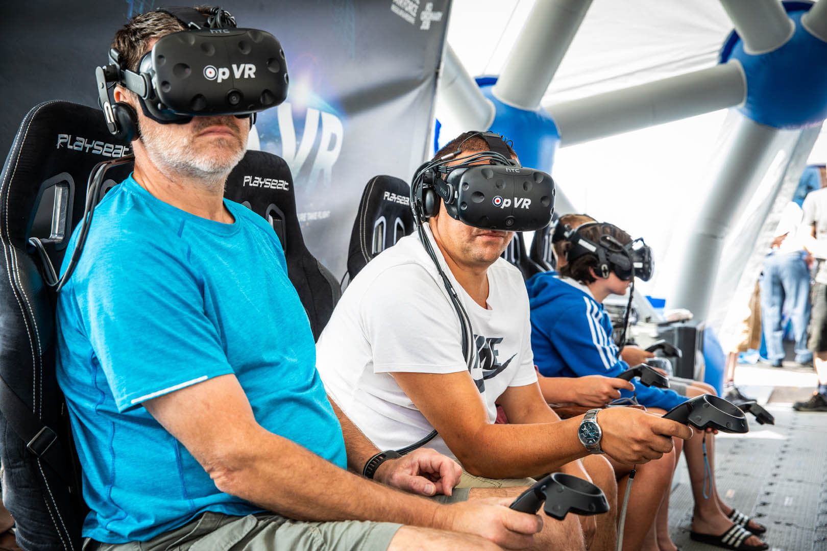 Visitors enjoy a go on the VR headsets at the RAF village