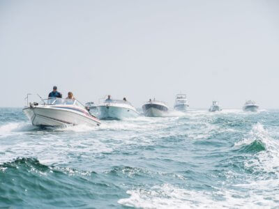 Sunseeker boats driving in formation across the sea