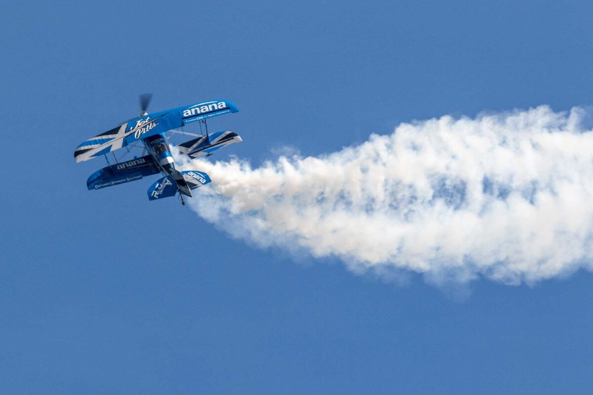 Super Pitt plane putting on a show for the crowds at the air festival in the Bournemouth skies