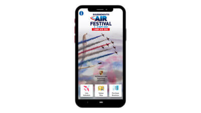 Mock up of the Air Show app with red arrows as the background image on the phone